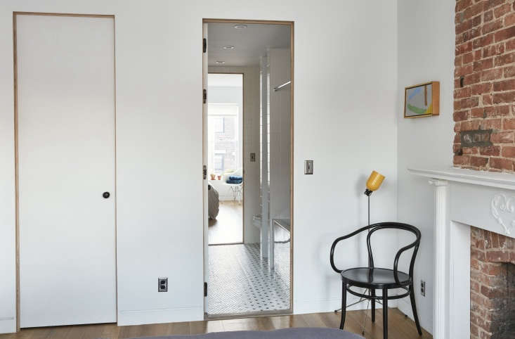 Two bedrooms share an adjoining bath. The walls here (and throughout the house) are painted Benjamin Moore Decorator&#8