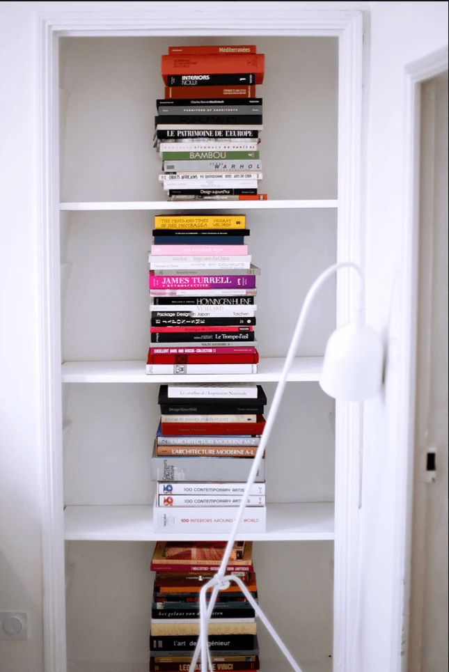 design and architecture books, stacked artfully on built in shelves. 20