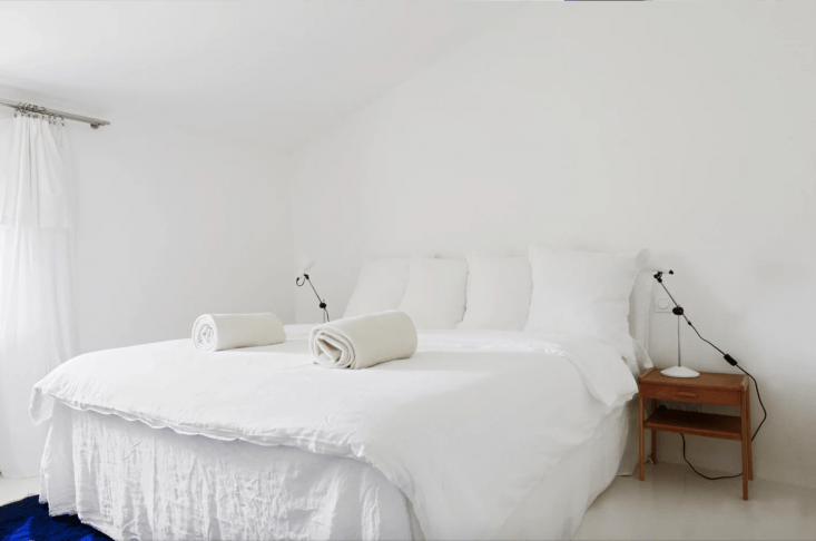 each of the five guest rooms is outfitted in all white linens, walls, floors, a 16