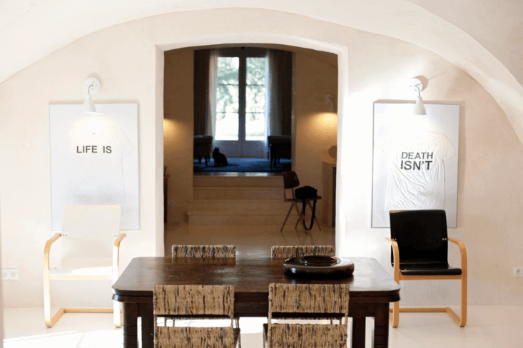 framed and lit contemporary art gives the dining room the feel of an eclectic g 12