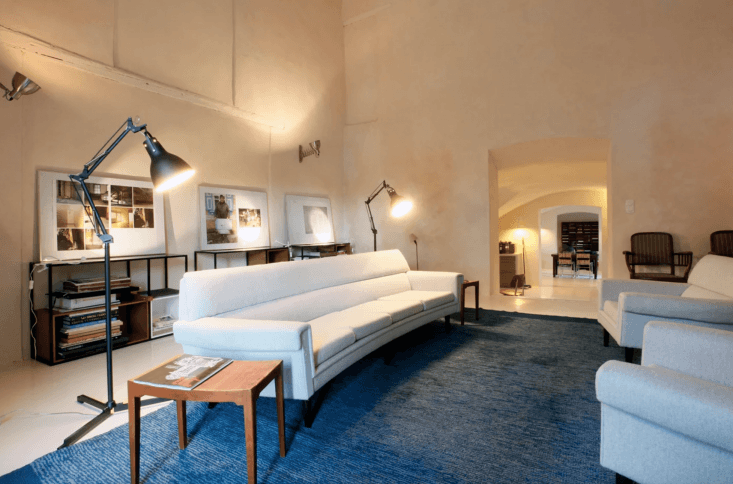 theliving room has mixes utilitarian reading lamps with soaring ceilings and  14