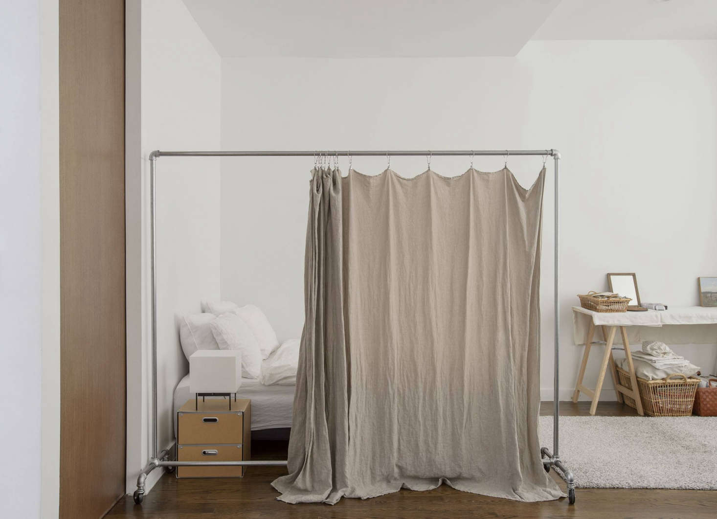 For a softer divider, we like the idea of curtains, but hanging one from the ceiling requires hardware and drilling holes. For less impact, try this hack from shopowner Makié Yahagi&#8