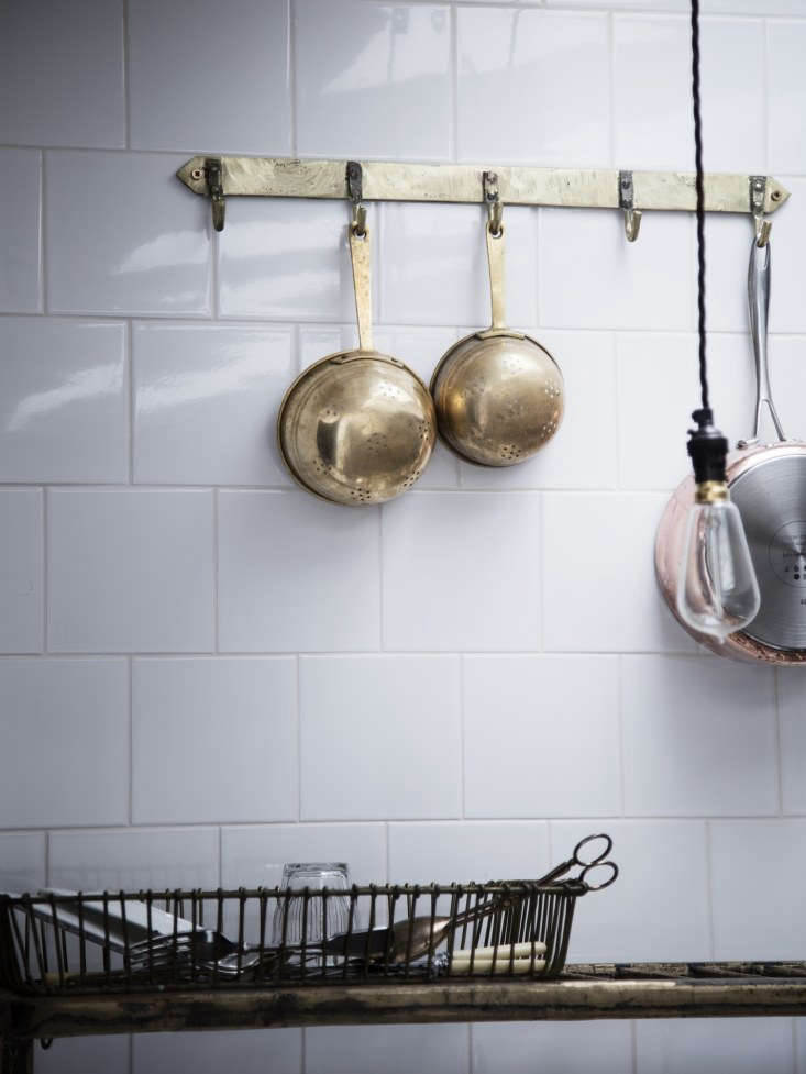 Kitchen of the Week A Family Gathering Spot in a London Victorian Antique brass colanders hang from a Cast Bronze Pan Rack; £95 (\$\1\25.38). Under it, a wall mounted Cast Bronze Draining Rack, £650 (\$857.87) holds a vintage wire draining basket that Lewis is thinking of reproducing.