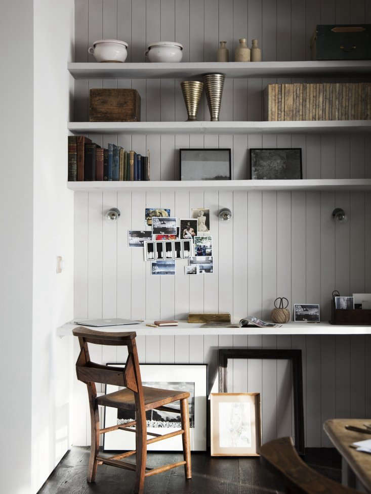 Kitchen of the Week A Family Gathering Spot in a London Victorian Lewis used an existing alcove in the back of the kitchen to create a built in desk and shelves made from scaffolding planks. The area is used by the family for doing homework, charging laptops, and looking up recipes.