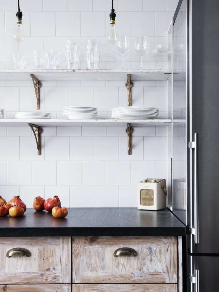 Kitchen of the Week A Family Gathering Spot in a London Victorian The open shelves are whitewashed floorboards supported byStrong Boy Cast Bronze Brackets; £39 (\$5\1.47). Note the stainless steel, full size fridge at the end of the counter.