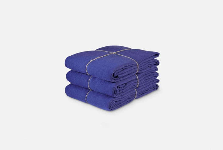 Merci, the grandmother of bright washed linen bedding, does a rotation of colors each season—Overall Blue washed linen Flat Sheet is one of  current colors; €0 ($5) at Merci.