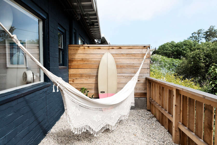 Rooms open onto private patios that include artisan-made hammocks for outdoor lounging.