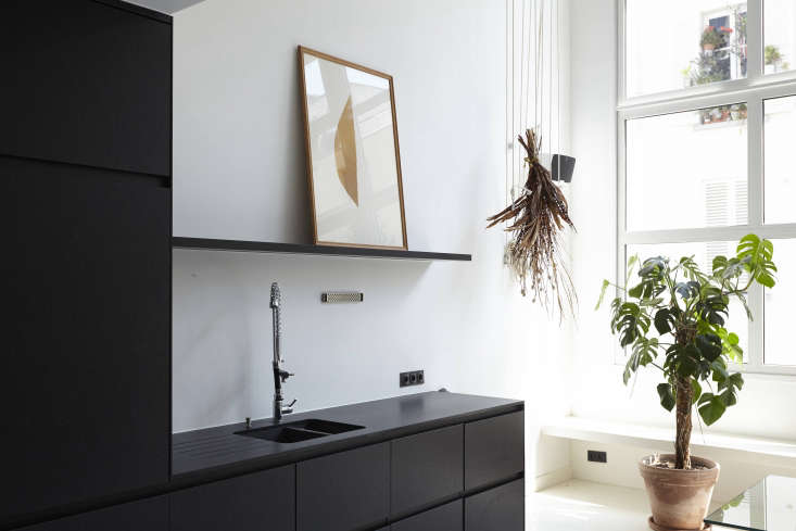 Sisto sourced the commercial-style kitchen faucet from a local restaurant supply store. The rope system is ridged to hang bunches of dried flowers and air plants. Behind it is a Sonos Play 5 System.