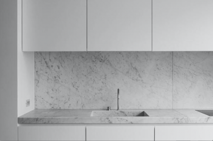 A Carrara marble counter in a Brussels loft by Nicolas Schuybroek is distinguishable by its soft, feathery veining. See more at Trend Alert:  Integrated Marble Kitchen Sinks.