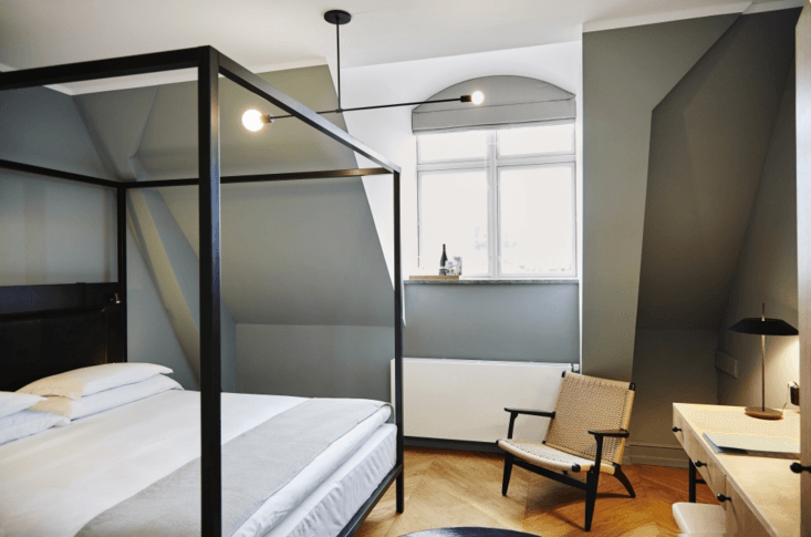 The guest rooms are outfitted with small rugs by Swedish brand Kasthall, but otherwise, the wood floors are left bare for a clean, unfussy look.