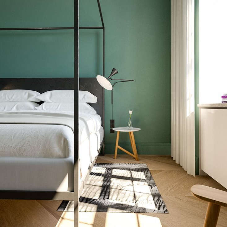 Black four-poster beds emphasize the historic building&#8