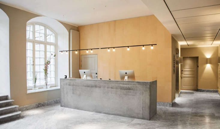 The concrete reception desk. Wingårdh was inspired by Le Corbusier's Sainte Marie de La Tourette monastery in Lyon, France; the marble and concrete lobby and reception desk, with low lines and brutalist notes, is reminiscent of the concrete structure.