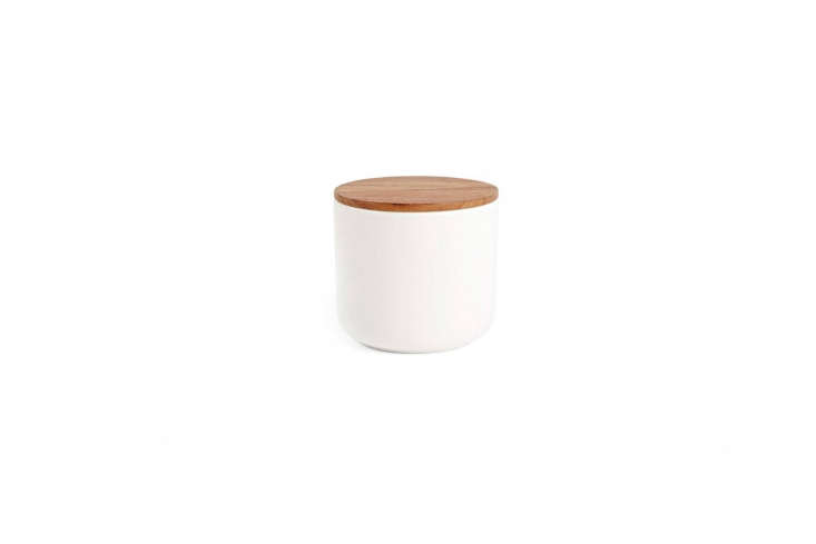 Store soaps and toiletries in stoneware Canister with Wood Lids available in the large size for $39 each at Rejuvenation. (For a &#8