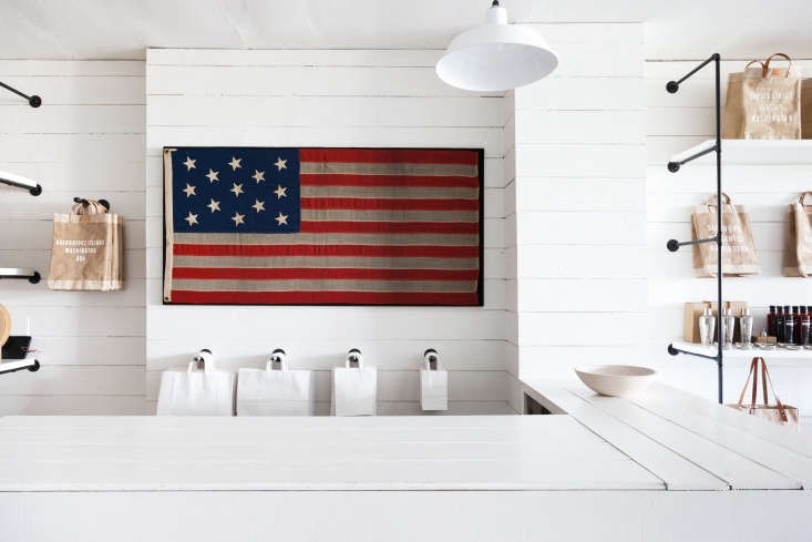 A vintage American flag hangs above the retail counter. It&#8