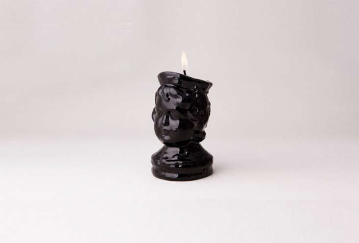 the black wax boy's head candle is from the oldest candlemaker in lisbon, por 11