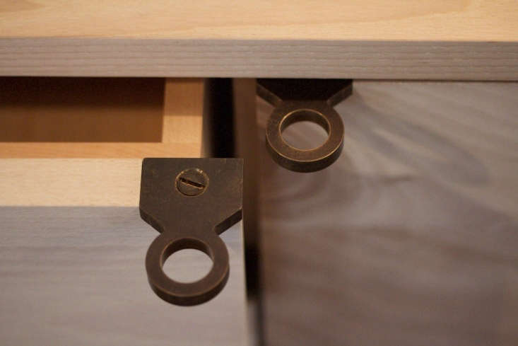 Oval and Trigger Handmade Blackened and Brass Hardware from Sawkille Co The Trigger Drawer Pull, at work.