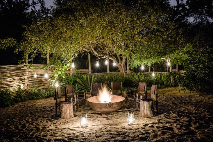 guests are encouraged to congregate around the fire pit for a cocktail before t 14