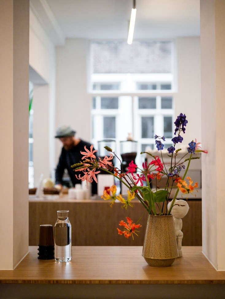 an inset shelf holds flowers and a carafe of water. 15