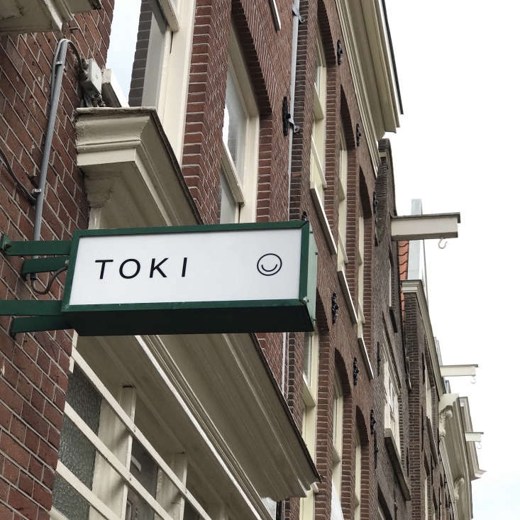 exterior sign at toki cafe in amsterdam 19