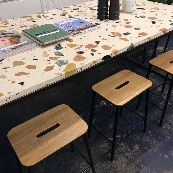 stools at the marmoreal counter. 12