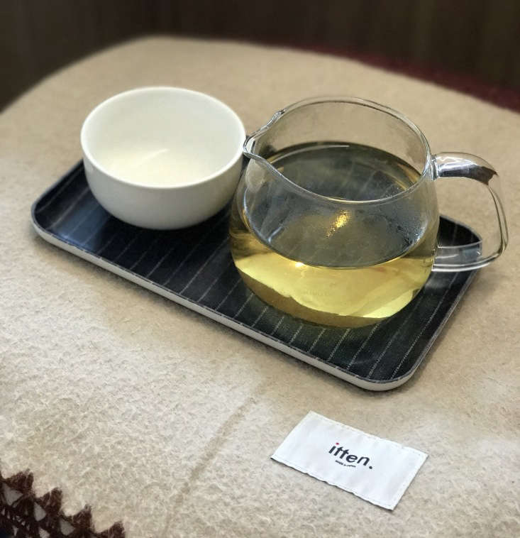 tea is served in a pitcher by japanese brand kinto on a fog linen coated tray.  18