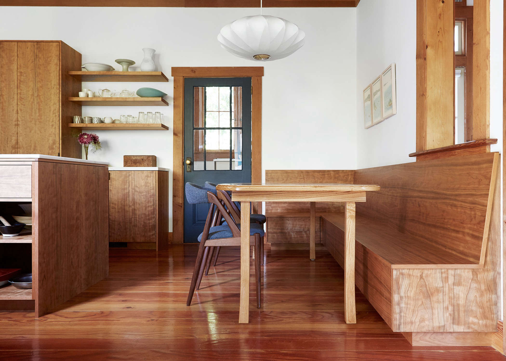 A custom-built cherry booth in the Oakland, California, house of photographer Aya Brackett fromKitchen of the Week: Aya Brackett's Hippie House Update in Oakland.