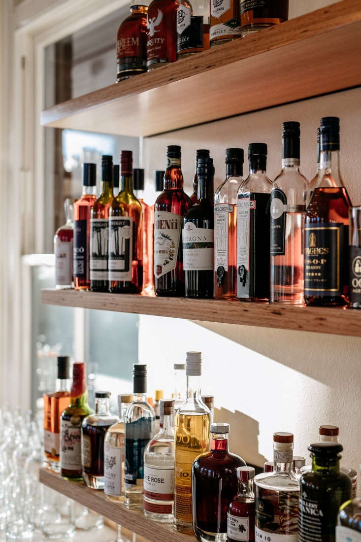 on the bar wall, pink and amber liquors offer a warm glow. 12