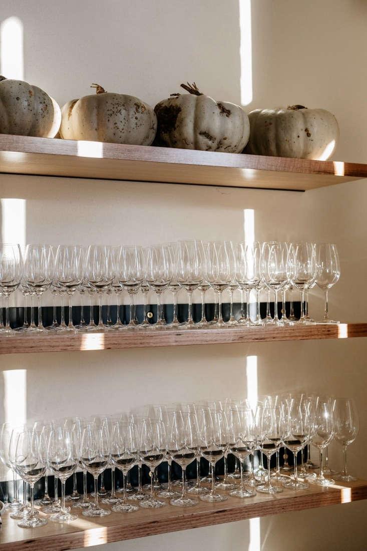 agrarian kitchen tasmania dining room wine glasses pumpkins