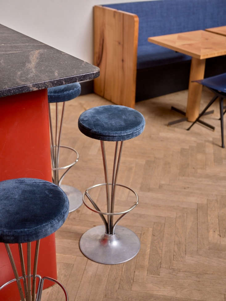 The barstools are Piet Hein for Fritz Hansen that Johansen upholstered with blue velvet.