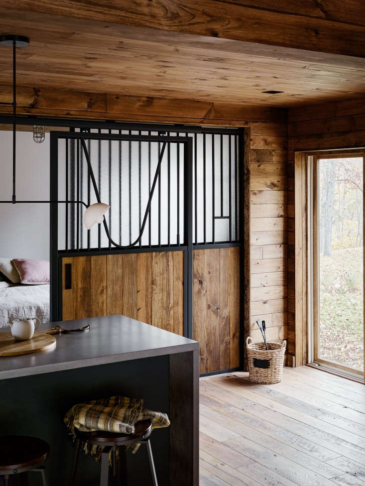 The interior walls are stained shiplap pine, and the floors are reclaimed Hit or Miss Oak from LV Wood in New York City.