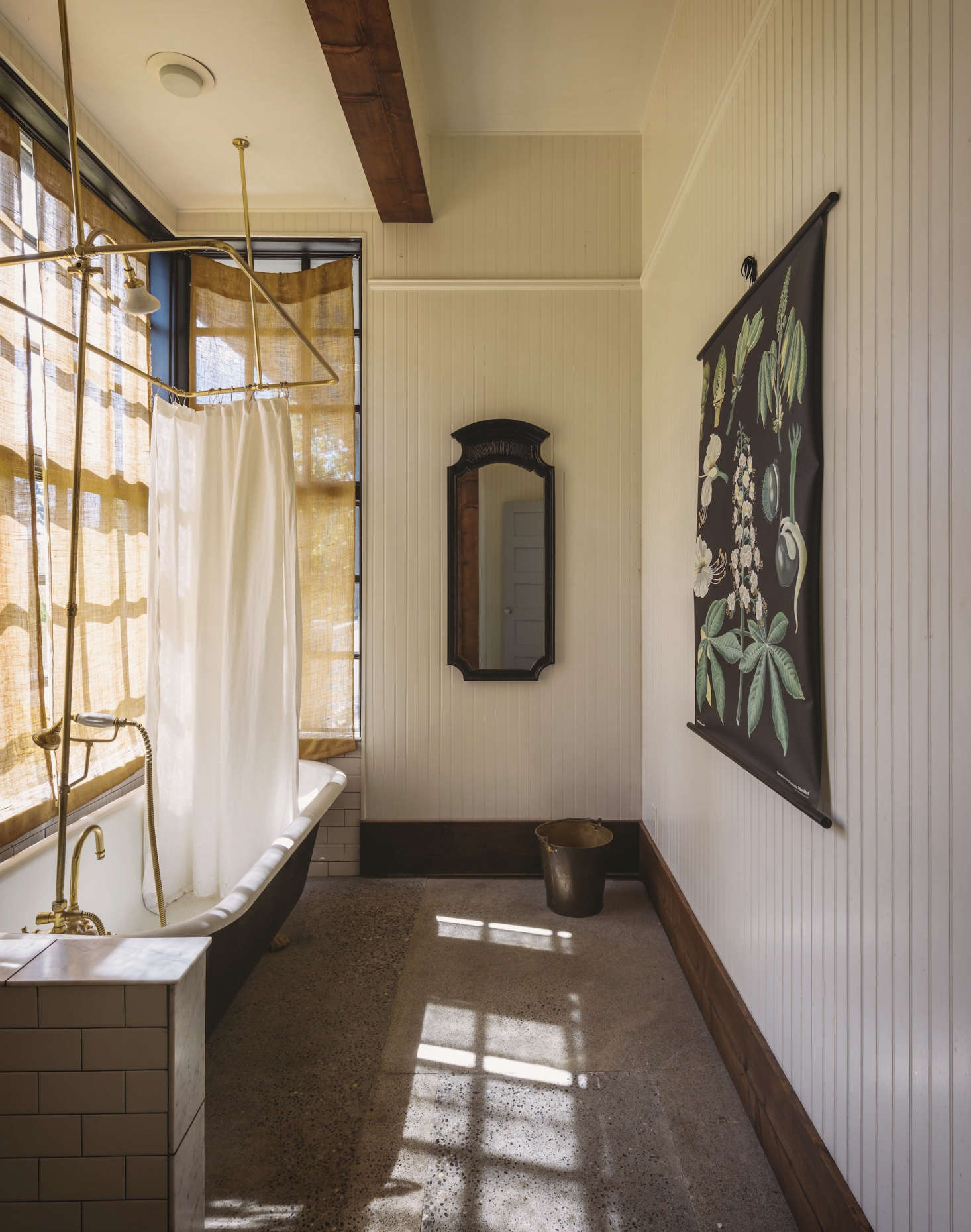 When Seattle chef Matt Dillon remodeled a bathroom at his farm onVashon Island, Washington, its concrete floor was preexisting but needed to be demoed when plumbing was added. Dillon and his contractor patched the floor and polished it with acid etching. See more in Bathroom of the Week: A Vintage Bath on Old Chaser Farm on Vashon Island, Washington. Photograph by Aaron Leitz for Remodelista.