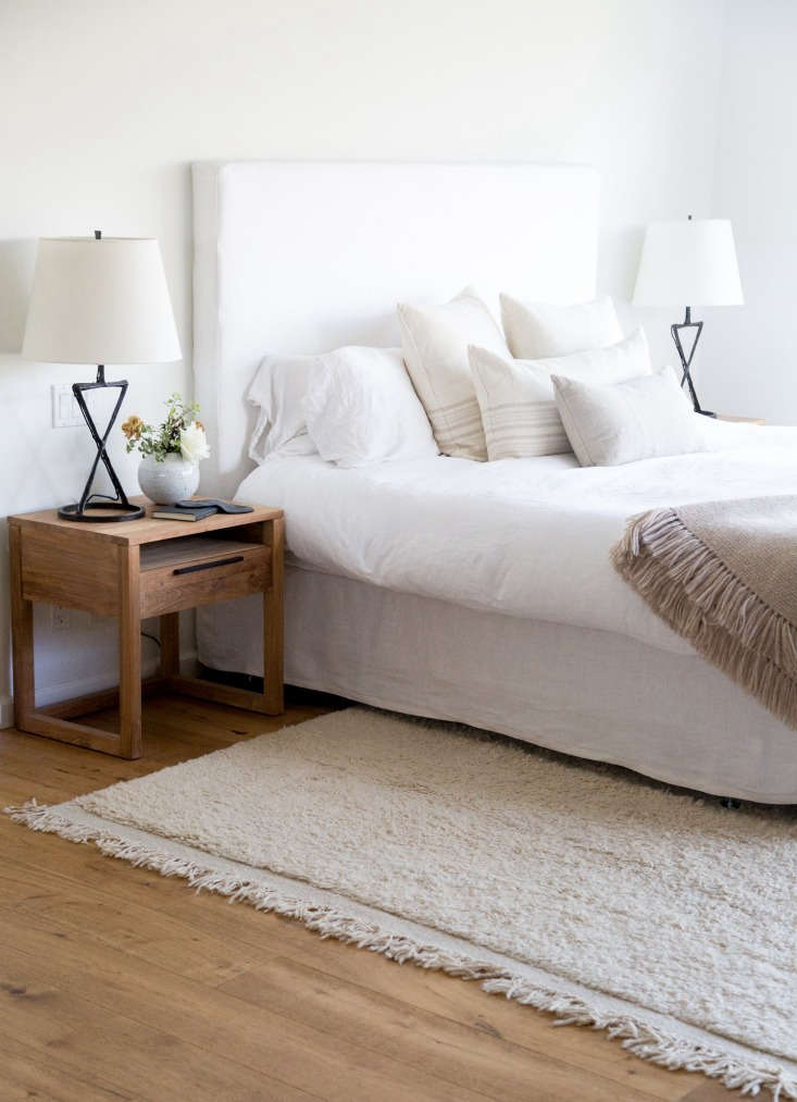 Hunter worked with interior designer Caroline Wolf on the master bedroom. The bedspread is from Matteo, and all the throw pillows are from Jenni Kayne Home: a Linen Seam Rectangle Pillow ($loading=