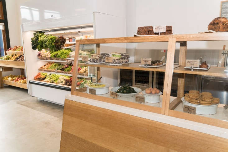 Marta and Robert keep deli goods and fresh farm eggs on ceramic dishes in a wood and glass case.