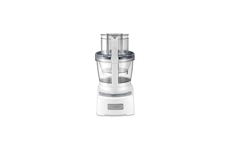 10 Easy Pieces Food Processors The Cuisinart Elite Collection Food Processor has a \1\2  and four cup bowl, small and large cutting and shredding disks, and a \1,000 watt motor; \$\160.\20 on Amazon. The Cuisinart Elite is rated high for slicing and noise (it's quiet) but low for pureeing and grating by Consumer Reports.
