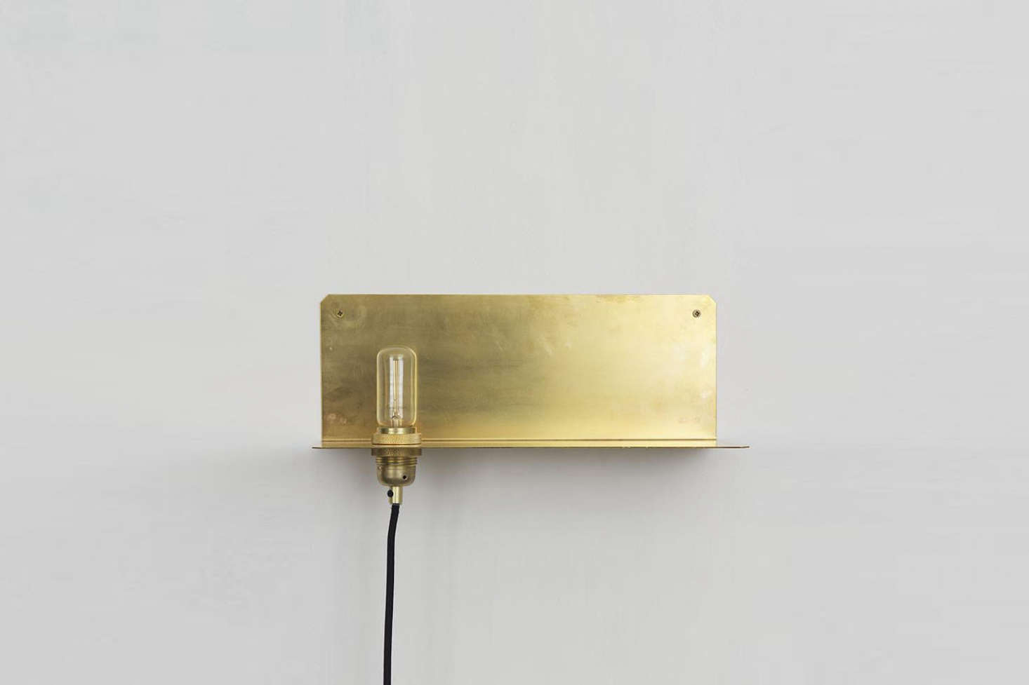 The Frama 90-Degree Wall Light in brass is $365.3