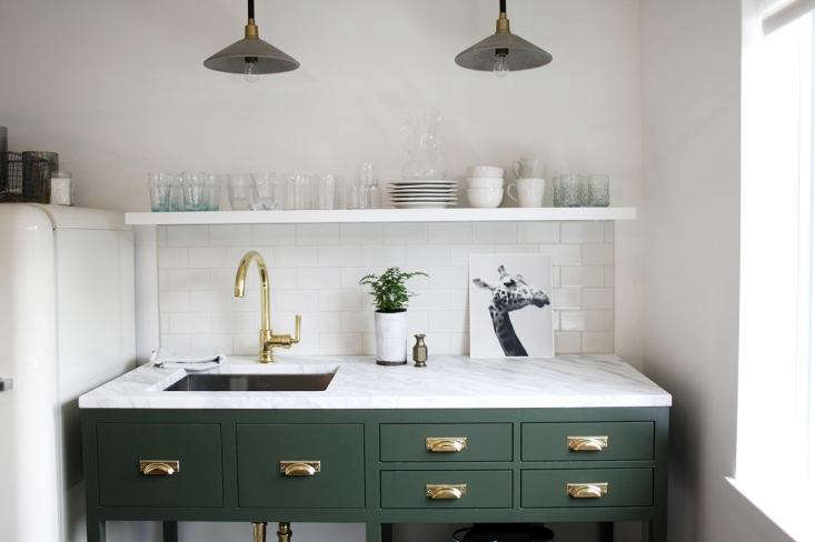 Even a petite kitchenette, like this one in a Seattle office, can accommodate a sink suitable for washing dishes and hands. For more sinks in tiny kitchens, seeTrend Alert:  Well-Designed Kitchenettes.Photograph byBelathée Photographyand courtesy ofH