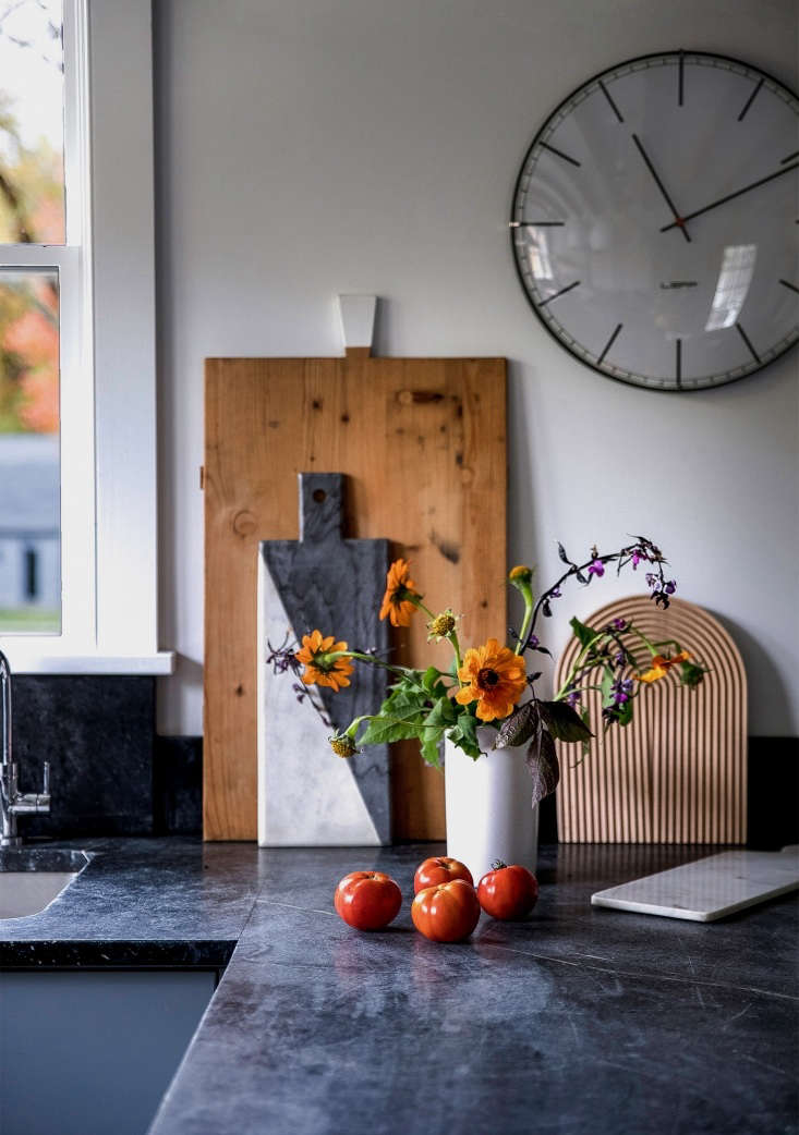Kitchen of the Week Hudson Valley Farmhouse Kitchen Reborn Bounty from Dunja&#8\2\17;s garden: Tomatoes and flowers add a bit of autumnal color. Against the wall rest a vintage cutting board, which Dunja bought at Brimfield, a two toned marble board by Jonathan Adler, Hay&#8\2\17;s Field Cutting Board (available at Finnish Design Shop; \$60) and another smaller marble board fromHammertown in Rhinebeck. Leff&#8\2\17;s Large Index Wall Clock is available at Lumens; \$99.