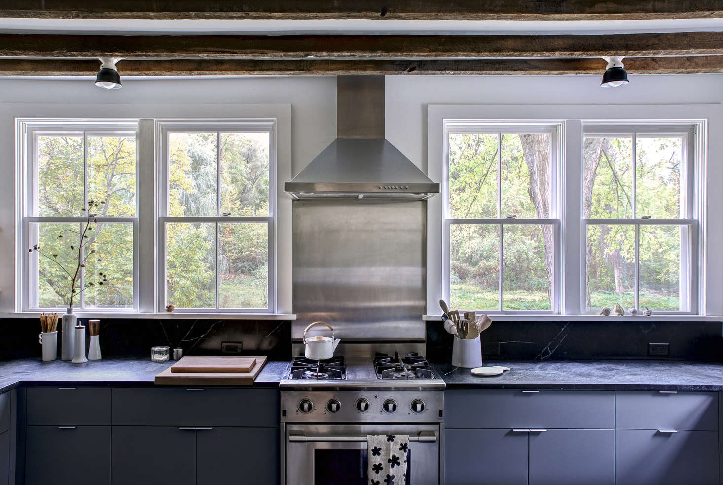 Dunja replaced three small, central windows with four more generous specimens from Marvin, which now frame a NXR stoveand make the most of the woodland view.