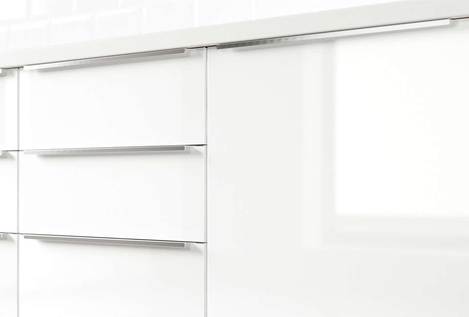 The kitchen is made up ofglossy white laminate Abstrakt cabinets from Ikea, a kitchen cabinet style no longer available. Ikea&#8