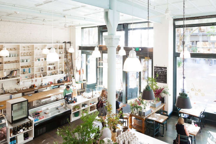The London Plane is a multifaceted place: a sit-down restaurant plus flower studio with bar, takeaway, retail, and choose-your-own bouquet stand.
