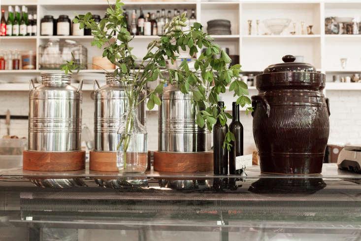 Three Italian stainless steel fustis, whose original purpose is to store olive oil, evoke Mediterranean climates.