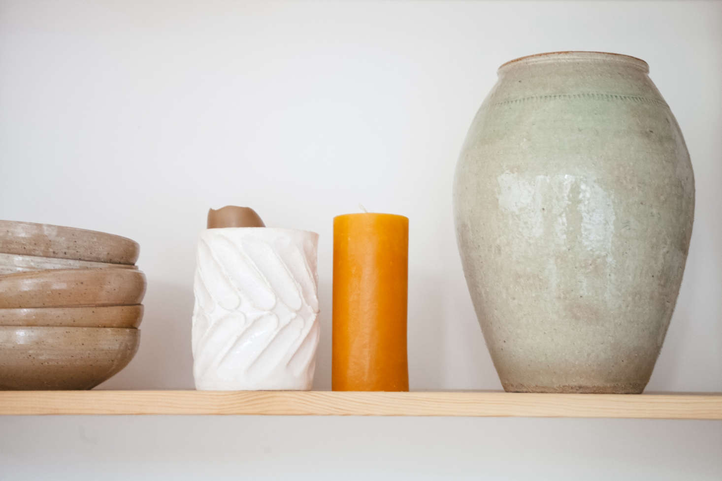 The white vase with fingerprints is by Lucile.