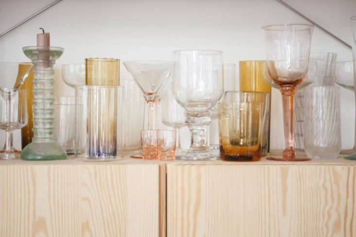 Modern Thrift Lucile Demorys ArchitectDesigned Rental in Paris Glassware in shades of amber, pink, and green.