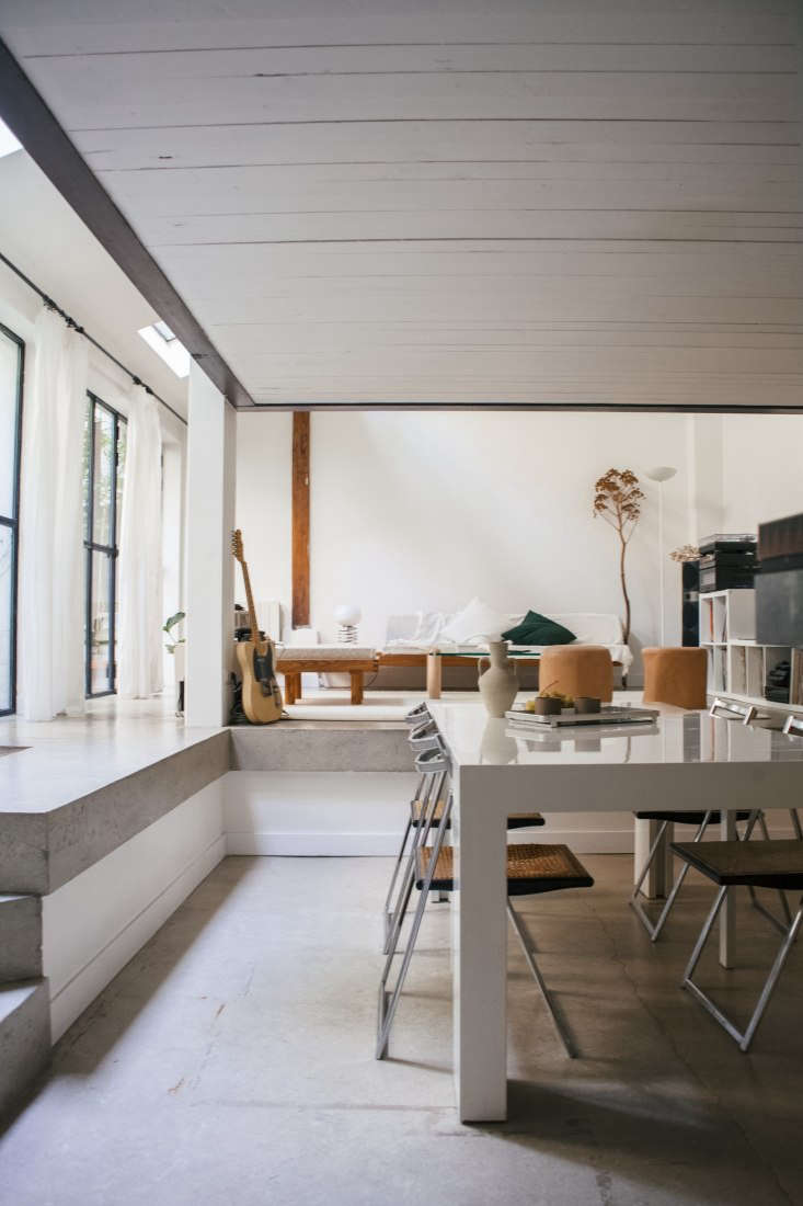 Modern Thrift Lucile Demorys ArchitectDesigned Rental in Paris A view from the kitchen into the two tiered living/dining space.