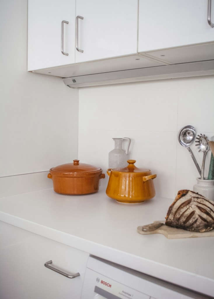 Modern Thrift Lucile Demorys ArchitectDesigned Rental in Paris Lucile and Michel keep the small kitchen spare. On the counter are two stoneware cook pots, bought at a thrift store. The bread on the counter is from Paris bakery Du Pain et Des Idées.