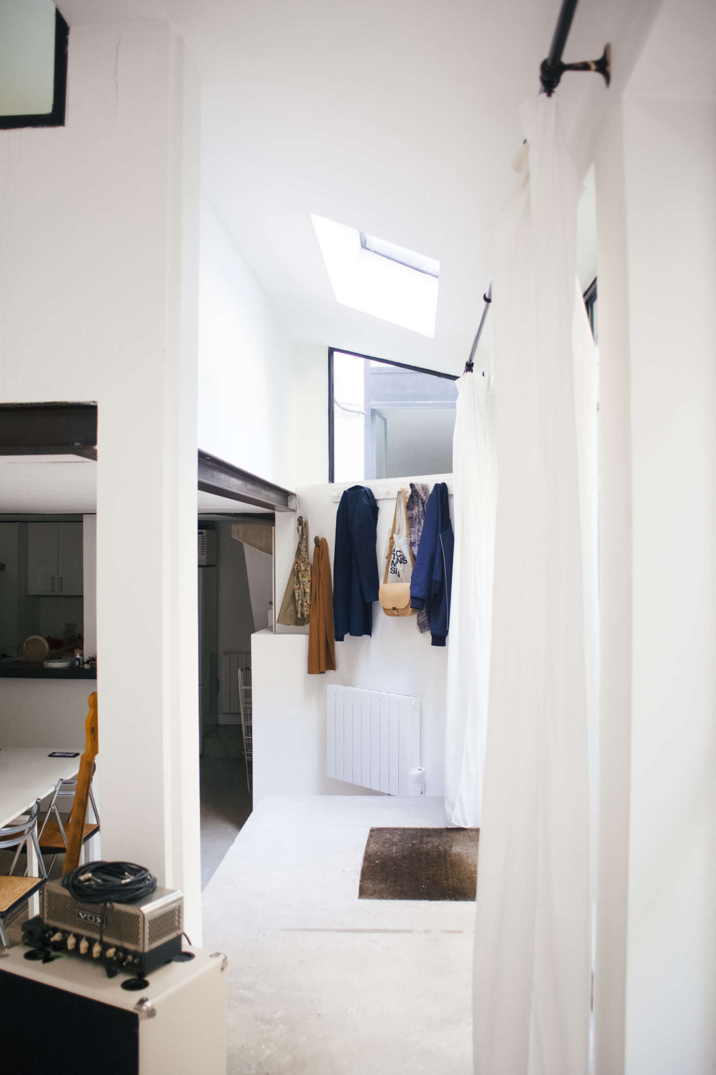 The inset coco mat came with the apartment. Lucile and Michel created an instant entryway with a white-painted peg rail.