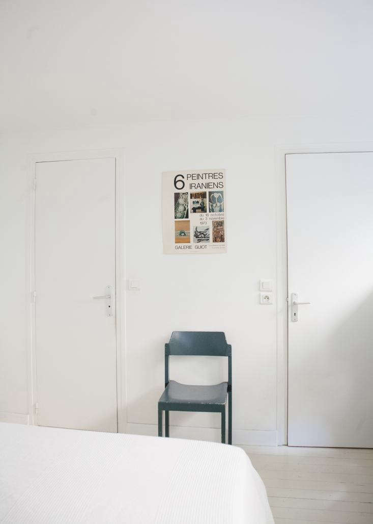 Modern Thrift Lucile Demorys ArchitectDesigned Rental in Paris Clarisse gave Lucile the school chair, one of a batch she sourced for a restaurant design, and the poster from a \1973 Iranian painters exhibition.