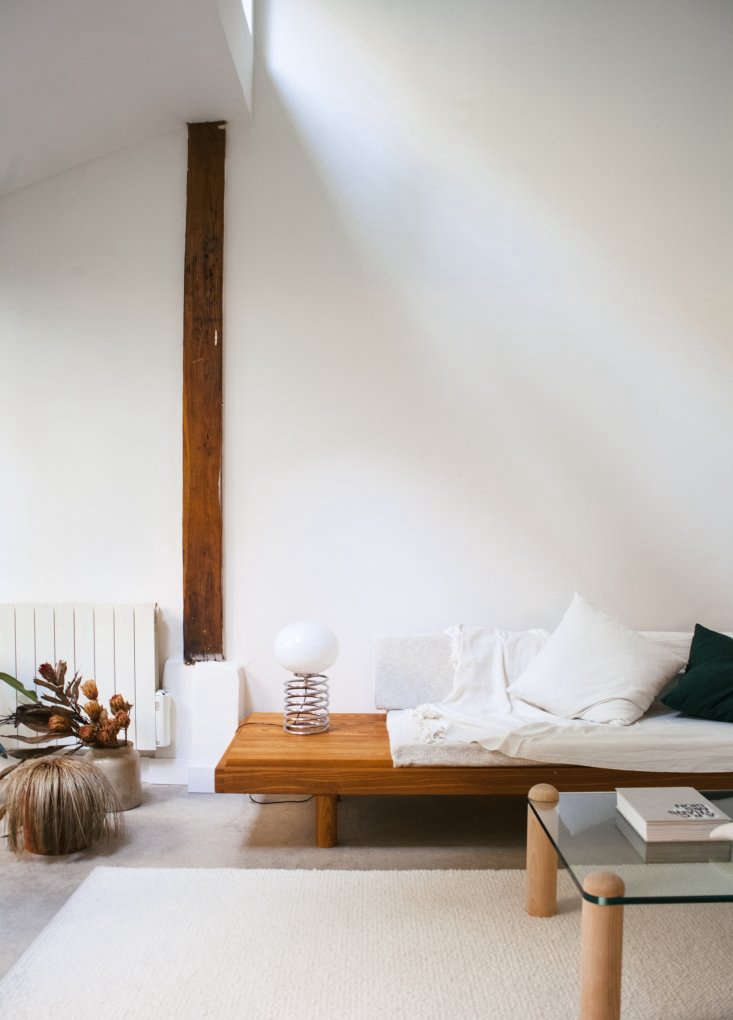 Modern Thrift Lucile Demorys ArchitectDesigned Rental in Paris The sofa and ottoman are part of a \1960s daybed set by French designer Pierre Chapo. The lamp is a Spirale Desk Lamp by Ingo Maurer for Design M.
