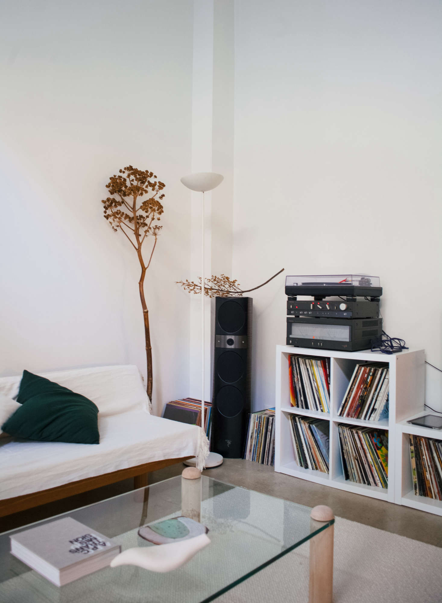 A 90s halogen floor lamp of Michel's illuminates a corner; the speakers are fromFocal and the turntable is aTechnics src=