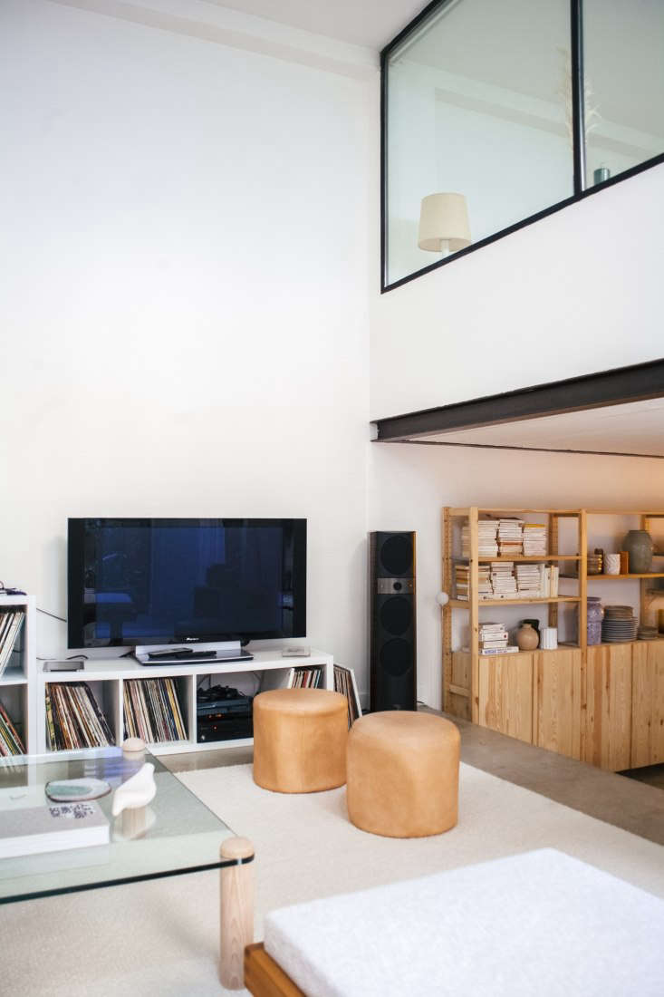 Modern Thrift Lucile Demorys ArchitectDesigned Rental in Paris The two vintage leather poufs are from a Paris thrift store.